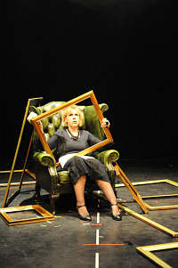 Peer Gynt Recharged: Woman in chair with frame on her lap
